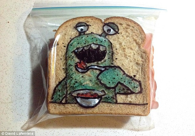 Monster munch: Mr Laferriere's sons don't see his drawings until they open their lunch at school