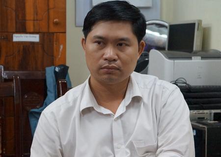 Đối tượng Nguyễn Mạnh Tường tại cơ quan công an (Ảnh: Việt Dũng/VNE)
