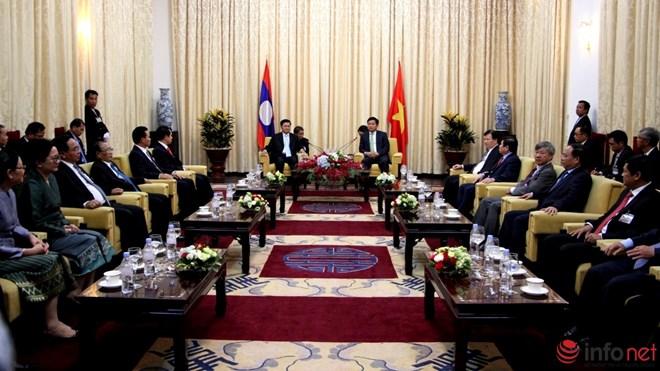 Phút đối thoại thú vị trong cuộc gặp giữa ông Đinh La Thăng và Thủ tướng Lào - Ảnh 1.