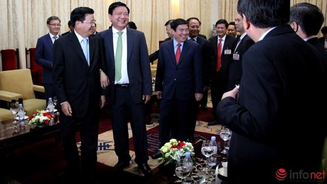 Phút đối thoại thú vị trong cuộc gặp giữa ông Đinh La Thăng và Thủ tướng Lào - Ảnh 3.
