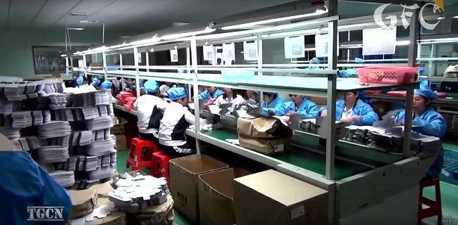 Cận cảnh quá trình sản xuất điện thoại công nghiệp của Trung Quốc - Ảnh 7.