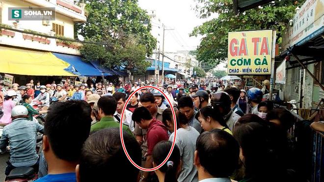 Cô gái dùng mũ bảo hiểm đánh tới tấp tên cướp giữa phố Sài Gòn - Ảnh 1.