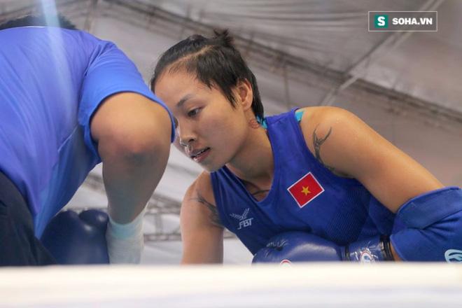Nữ võ sĩ Việt đá đo ván đối thủ Trung Quốc sau tiếng còi 10 giây - Ảnh 1.