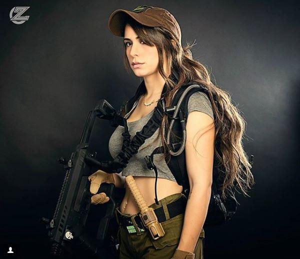 Vẻ sexy khó cưỡng bên cây súng của nữ binh sĩ Israel - Ảnh 9.