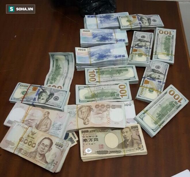 Khởi tố, tạm giam 2 kẻ trộm bọc tiền 6 tỷ đồng trên xe khách - Ảnh 1.