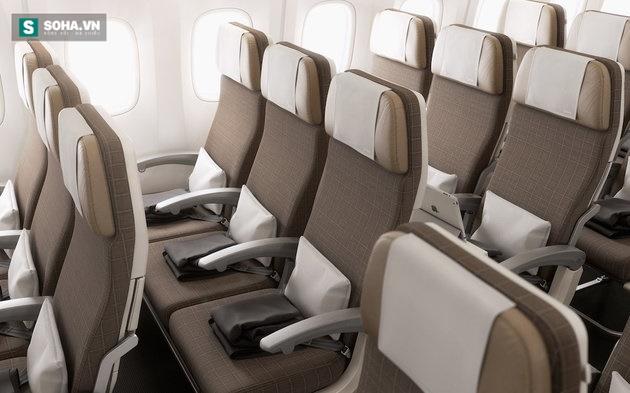Vì sao ghế ngồi trên máy bay thường không thẳng hàng với cửa sổ? - Ảnh 1.