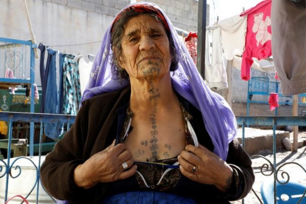 Những phụ nữ bất chấp đau đớn xăm hình lên người để chinh phục trái tim đàn ông - Ảnh 3.