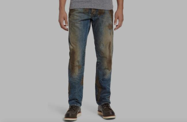 Mẫu quần jeans lấm lem bùn đất phong cách thợ hồ giá 9 triệu đồng - Ảnh 1.