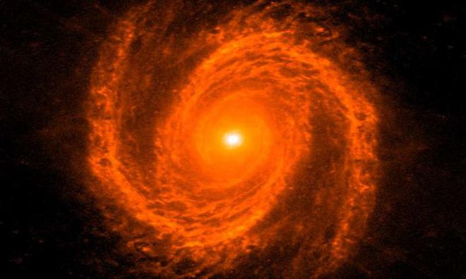 Các nhà khoa học vừa nghĩ ra cách cân khối lượng lỗ đen: dùng các nhánh xoắn ốc của thiên hà - Ảnh 2.
