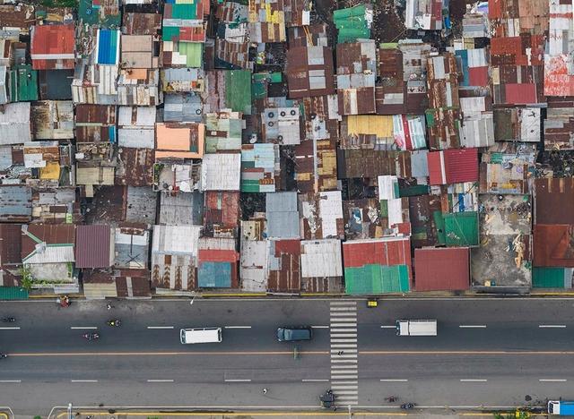 """Những hình ảnh """"nghẹt thở"""" về cuộc sống ở Manila - thành phố đông dân cư bậc nhất thế giới - Ảnh 11."""
