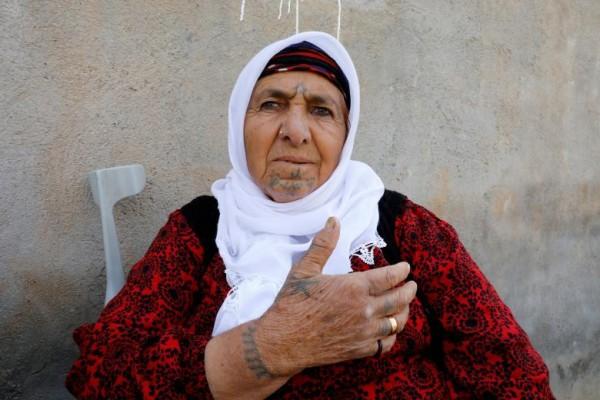 Những phụ nữ bất chấp đau đớn xăm hình lên người để chinh phục trái tim đàn ông - Ảnh 11.