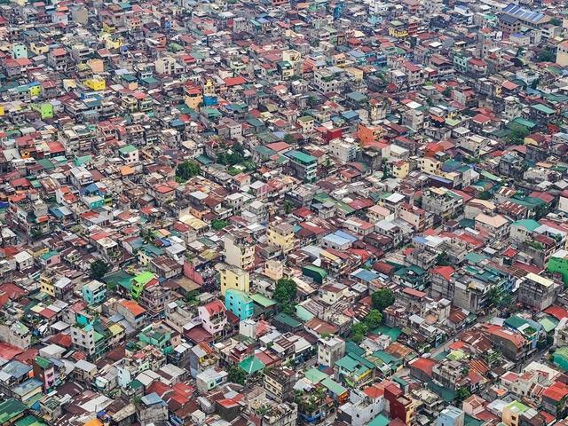 """Những hình ảnh """"nghẹt thở"""" về cuộc sống ở Manila - thành phố đông dân cư bậc nhất thế giới - Ảnh 12."""