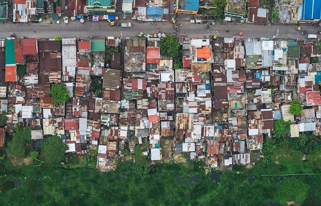 """Những hình ảnh """"nghẹt thở"""" về cuộc sống ở Manila - thành phố đông dân cư bậc nhất thế giới - Ảnh 14."""