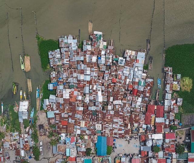 """Những hình ảnh """"nghẹt thở"""" về cuộc sống ở Manila - thành phố đông dân cư bậc nhất thế giới - Ảnh 4."""