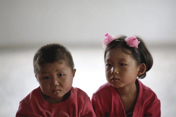 Hình ảnh hiếm về tuổi thơ của trẻ em Triều Tiên - Ảnh 5.