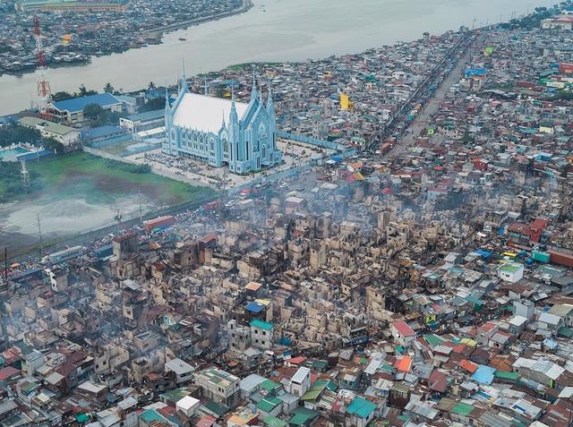 """Những hình ảnh """"nghẹt thở"""" về cuộc sống ở Manila - thành phố đông dân cư bậc nhất thế giới - Ảnh 6."""