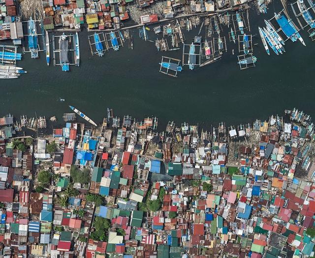 """Những hình ảnh """"nghẹt thở"""" về cuộc sống ở Manila - thành phố đông dân cư bậc nhất thế giới - Ảnh 8."""