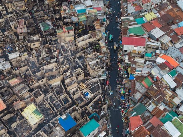 """Những hình ảnh """"nghẹt thở"""" về cuộc sống ở Manila - thành phố đông dân cư bậc nhất thế giới - Ảnh 9."""