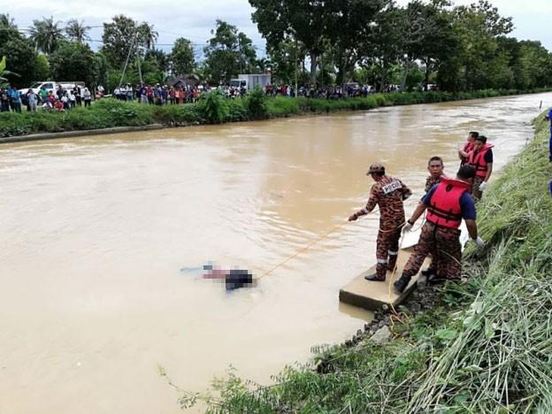 Cả gia đình nhảy sông tự tử, con trai cả thay đổi ý định phút chót, lên bờ kể lý do khiến mọi người sốc - Ảnh 2.