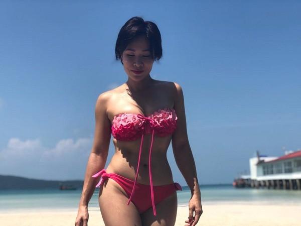 Hình ảnh bikini khỏe khoắn đầy sexy của Uyên Linh - Ảnh 4.