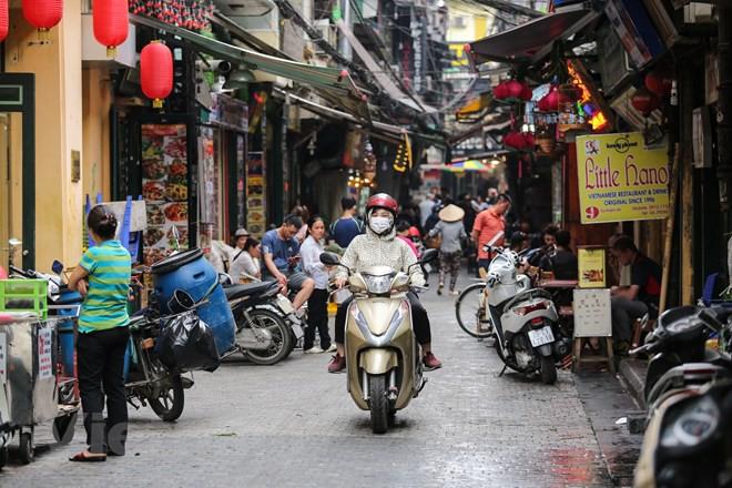 Nhìn lại vỉa hè Hà Nội một năm sau chiến dịch chống lấn chiếm - Ảnh 10.