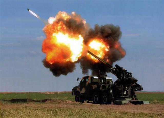 Lộ diện pháo tự hành bánh lốp 155 mm bí ẩn của Trung Quốc - Ảnh 2.
