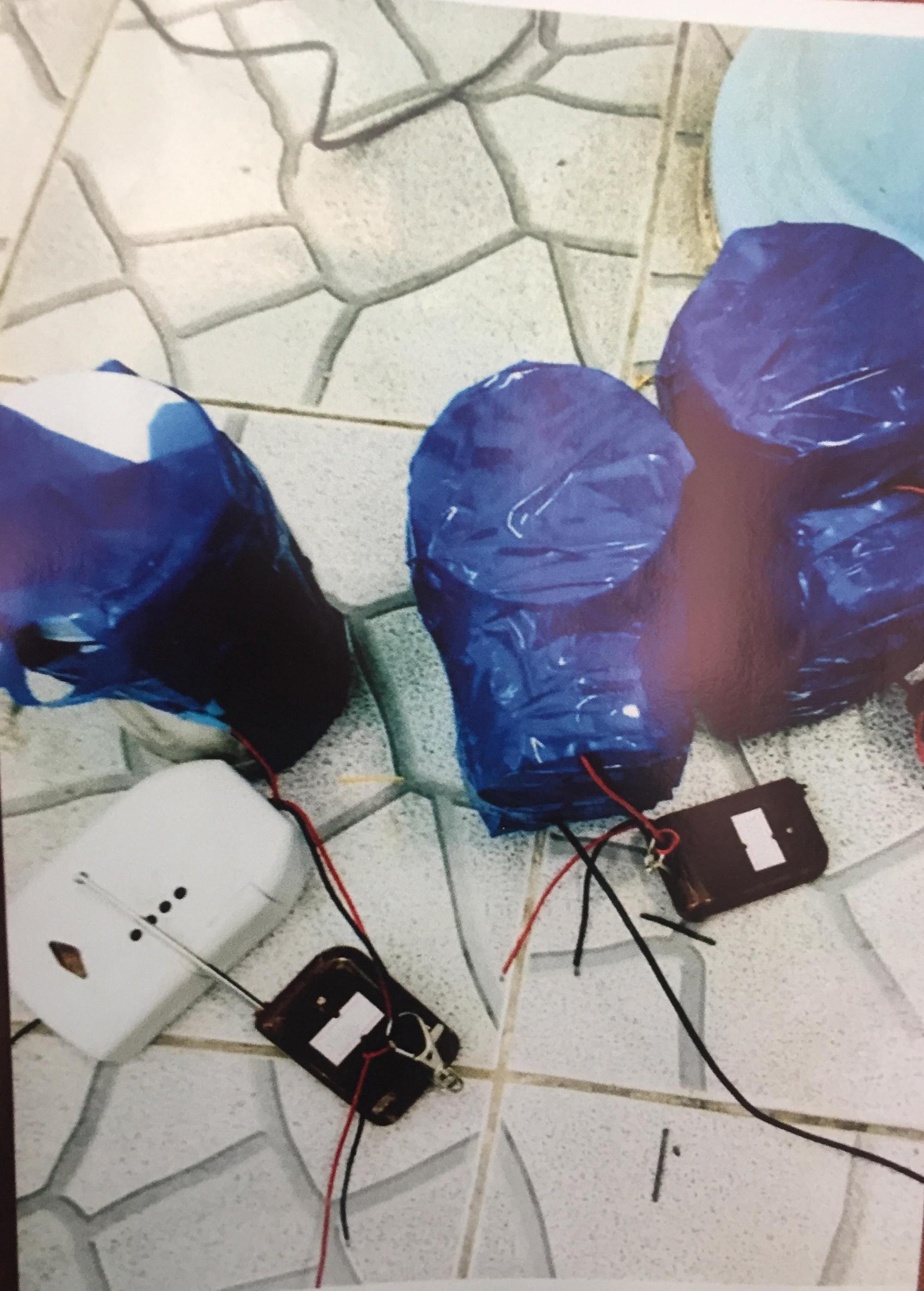[ẢNH] 10kg thuốc nổ trong nhà của kẻ ném bom vào trụ sở công an phường - Ảnh 12.