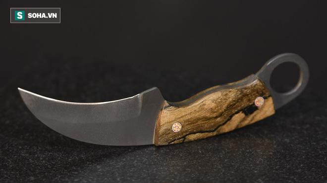 Sở hữu lưỡi dao cong hiểm hóc, đây là vũ khí cận chiến đáng sợ trong lịch sử - Ảnh 1.