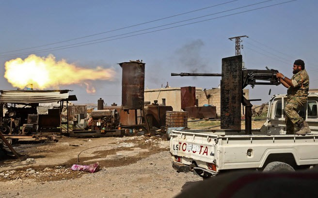 24h qua ảnh: Chiến binh Syria xả súng máy giáp biên giới Thổ Nhĩ Kỳ - Ảnh 3.