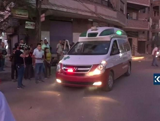 Quân đội Syria hợp lực với người Kurd, Thổ Nhĩ Kỳ tấn công xe chở người nước ngoài - Ảnh 11.