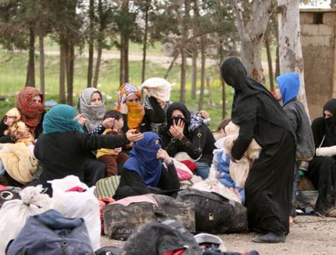 Quân đội Syria hợp lực với người Kurd, Thổ Nhĩ Kỳ tấn công xe chở người nước ngoài - Ảnh 20.