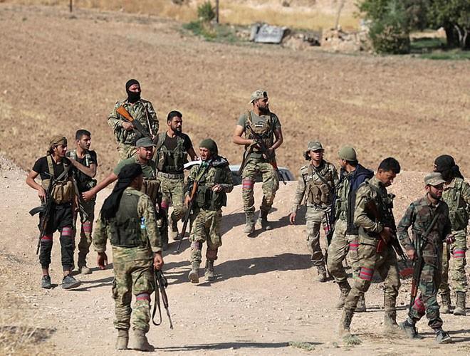 Quân đội Syria hợp lực với người Kurd, Thổ Nhĩ Kỳ tấn công xe chở người nước ngoài - Ảnh 5.