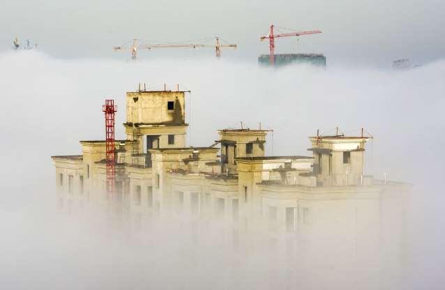 Vẻ đẹp của các thành phố trên thế giới khi chìm trong sương sớm - Ảnh 3.
