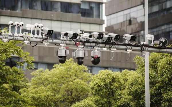 Mỹ bất ngờ trừng phạt 8 công ty công nghệ lớn của Trung Quốc vài ngày trước đàm phán thương mại - Ảnh 1.