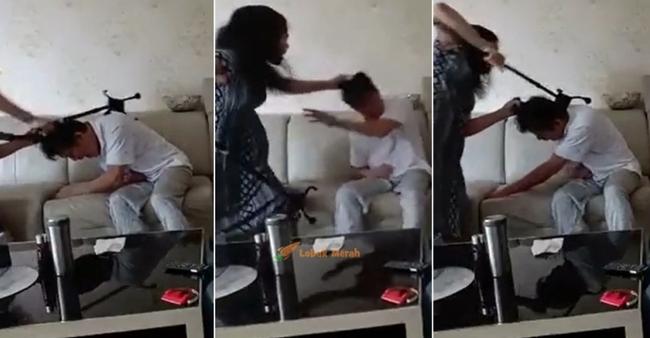 Đoạn clip vợ túm tóc, dùng gậy đánh chồng tới tấp trong khi nạn nhân kêu rên đau đớn gây xôn xao cộng đồng mạng - Ảnh 2.