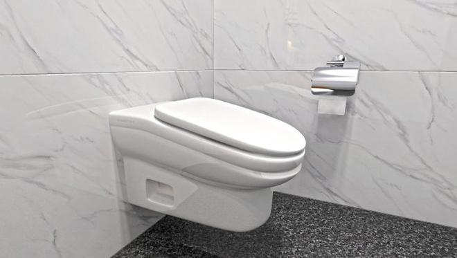 Mẫu bồn cầu ngăn nhân viên trốn việc vừa được phát minh, có thiết kế đặc biệt khiến người sử dụng không thể đi vệ sinh quá 5 phút - Ảnh 1.
