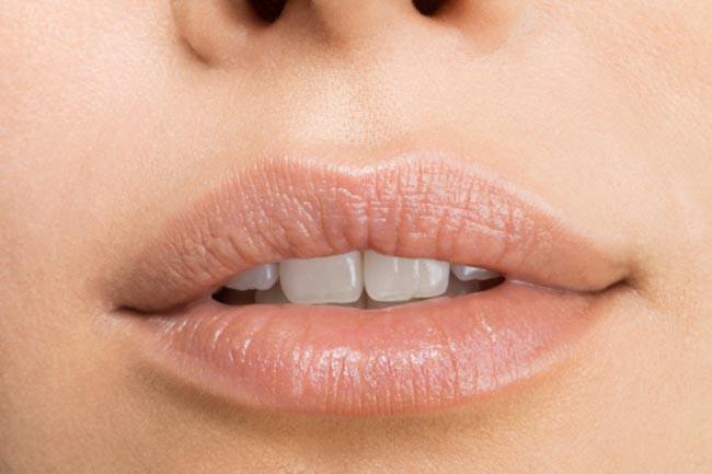 Nhận biết tình trạng sức khỏe qua các dấu hiệu của miệng - Ảnh 12.