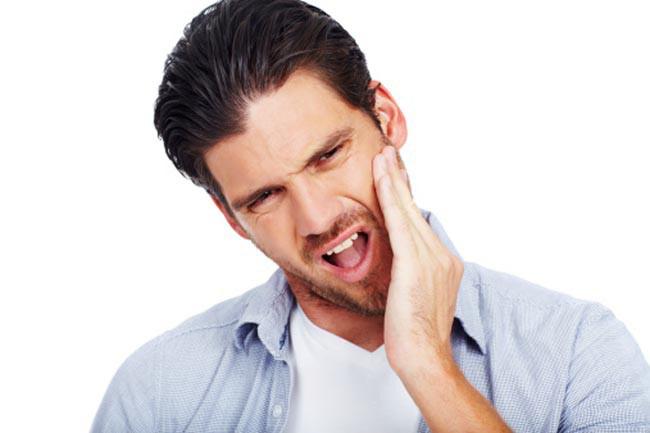 Nhận biết tình trạng sức khỏe qua các dấu hiệu của miệng - Ảnh 8.