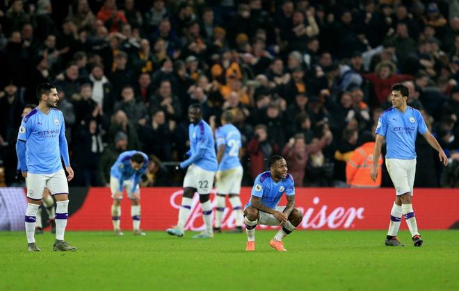 Thua ngược dù dẫn 2-0, Manchester City giương cờ trắng trong cuộc đua vô địch Ngoại hạng Anh - Ảnh 10.