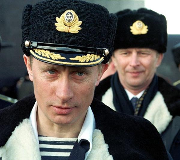 20 năm cầm quyền và những bức ảnh đậm chất Putin - Ảnh 2.