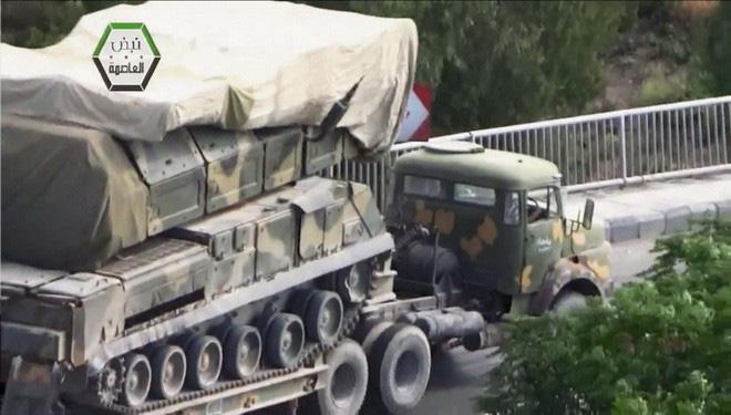 Hình ảnh sát thủ phòng không tầm trung Buk-M2E của Syria bị tấn công phá hủy - Ảnh 11.