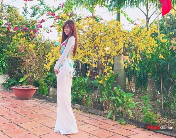 Nhật Lê, Quỳnh Anh và hội chân dài của ĐT Việt Nam hóa thiên thần với áo dài, bà ba đón Tết - Ảnh 3.