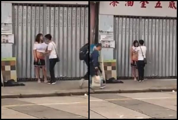 Cãi nhau với bạn trai, cô gái cởi đồ ngay giữa phố đông người - Ảnh 2.