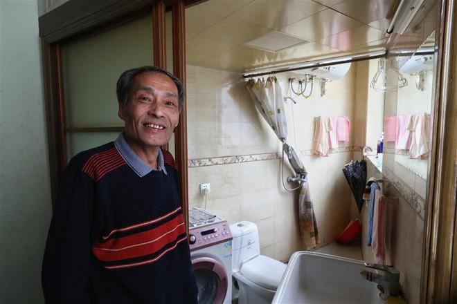 Cận cảnh cuộc sống lao đao trong tòa nhà mỏng như tờ giấy ở Thượng Hải - Ảnh 4.