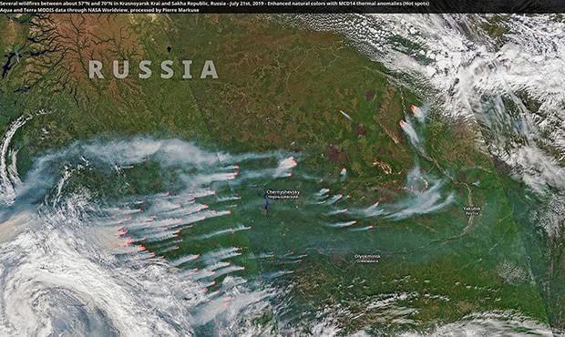 Khó tin nhưng có thực: Bắc Cực đang bốc cháy cực mạnh, và đám cháy ấy lớn đến mức nhìn thấy được từ ngoài vũ trụ - Ảnh 2.