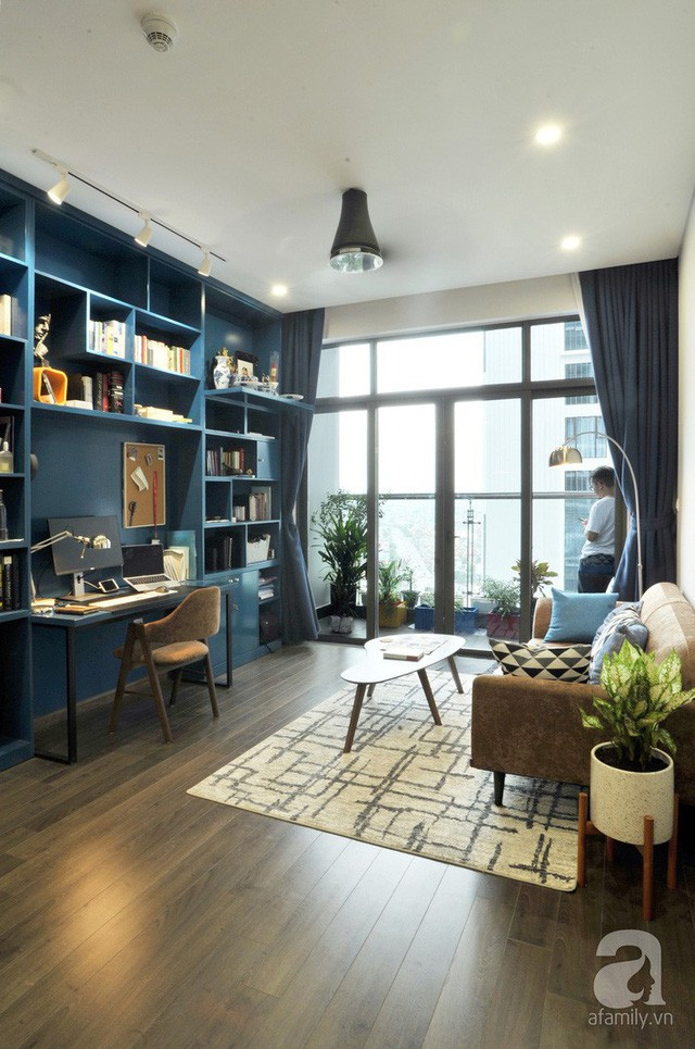 Căn hộ 90m² đẹp hiện đại với điểm nhấn màu xanh rất nam tính, có chi phí thi công 280 triệu đồng ở Hà Nội - Ảnh 1.