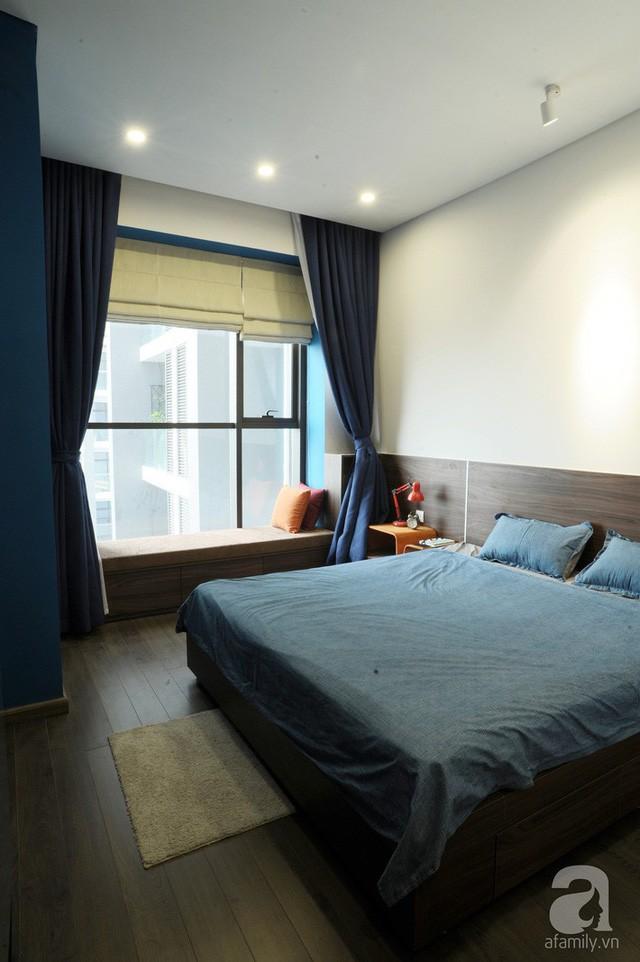 Căn hộ 90m² đẹp hiện đại với điểm nhấn màu xanh rất nam tính, có chi phí thi công 280 triệu đồng ở Hà Nội - Ảnh 10.