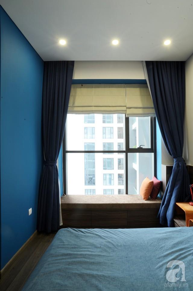 Căn hộ 90m² đẹp hiện đại với điểm nhấn màu xanh rất nam tính, có chi phí thi công 280 triệu đồng ở Hà Nội - Ảnh 11.