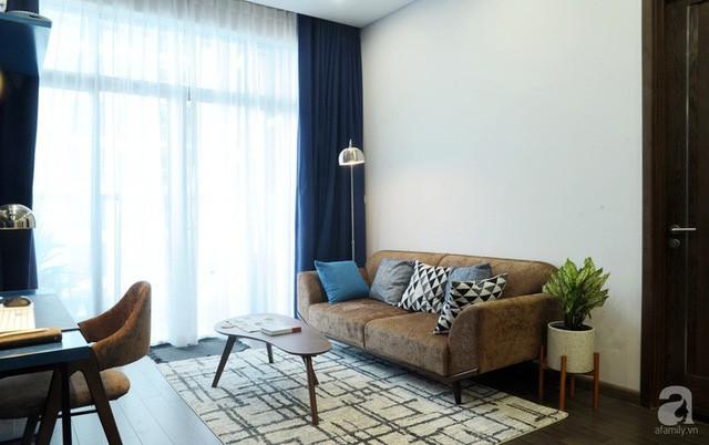 Căn hộ 90m² đẹp hiện đại với điểm nhấn màu xanh rất nam tính, có chi phí thi công 280 triệu đồng ở Hà Nội - Ảnh 3.