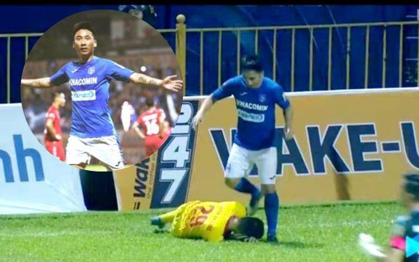 Phẫn nộ tình huống tiền vệ Quảng Ninh giẫm lên đầu cầu thủ Nam Định - Ảnh 1.